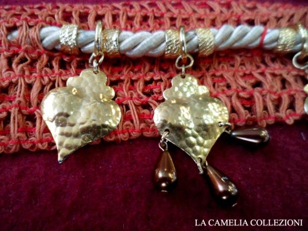 cinture vintage anni 60 - arancio con pendenti oro - la camelia collezioni