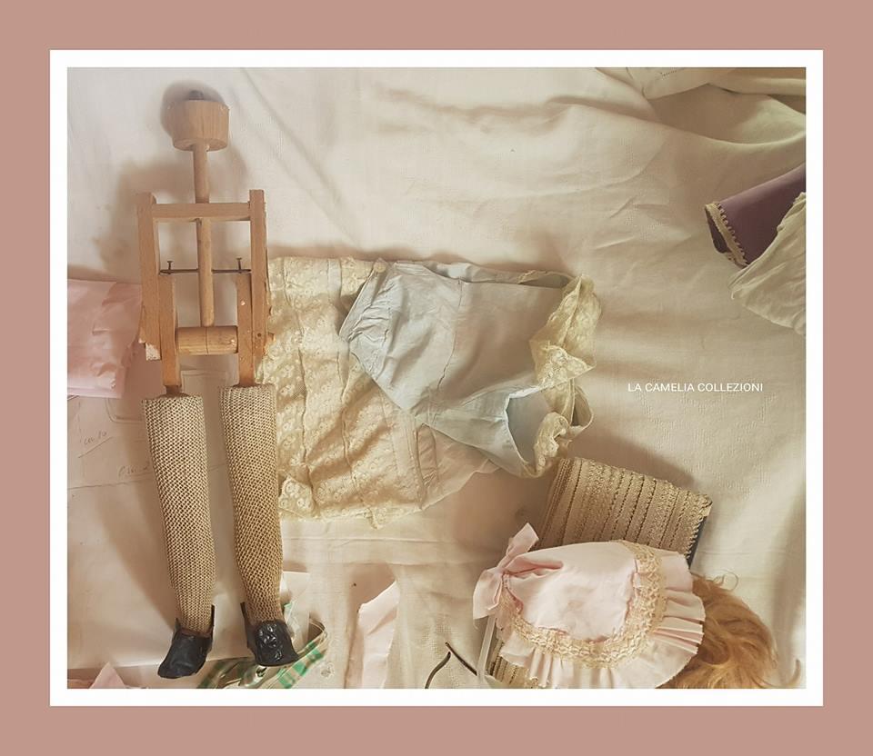 restauro bambole - sistemazione meccanismo interno - la camelia colllezioni